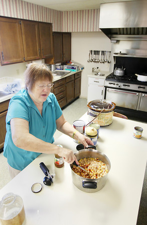 Record-Eagle/Keith King<br /> Gloria VanHoose, of Grawn, mixes ingredients to make white chicken chili Tuesday, January 8, 2013 at the Grawn United Methodist Church where a soup supper is scheduled for the second Saturday of the month for January, February, March and April as a fundraiser for a library in Blair Township. VanHoose is the secretary of the Blair Library Committee.