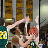 Record-Eagle/Jan-Michael Stump<br /> Central's Ben Lewis splits Midland Dow's defense.