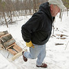 "Record-Eagle/Keith King<br /> Chester Lueck, of Traverse City, pulls wood in East Bay Township on Wednesday after cutting and splitting it for stockpiling and selling. ""I'm just an old guy getting exercise,"" Lueck said. ""The more you're outside, the better off you are."""