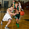 Record-Eagle/Jan-Michael Stump<br /> TC Central's Andrew Johnson (34) chases down a loose ball.