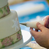 Record-Eagle/Jan-Michael Stump<br /> Grace Hanson decorates a cake in her home.
