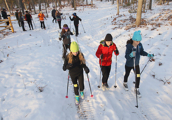 Record-Eagle/Keith King<br /> Lena Gerstle, from left, 12, Alexandra Stern, 12 and Amelia Burke, 12, all of Traverse City, march with ski poles Tuesday, January 15, 2013 during a Vasa Ski Club Jr. Program session at Timber Ridge Resort. The program, which is currently closed for enrollment, takes place on Tuesdays and Thursdays through February 28 with sixth, seventh and eighth-grade students participating. It was advised on this particular session that skis weren't worn due to trail conditions.