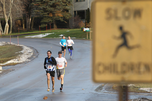 Record-Eagle/Jan-Michael Stump<br /> Runners make their way downhill on Quail Ridge Drive during Saturday's Frozen Foot Race, a 5 mile road race in Traverse City.