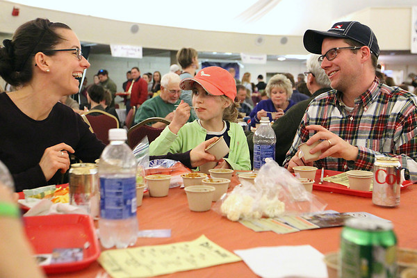 Record-Eagle/Jan-Michael Stump<br /> From left, Mary Paul, Anna Paul, 8, and Cary Paul (cq) taste their chili samples during Saturday's 18th Annual Downtown Chili Cook-Off in the Park Place Dome. Nearly 1,600 people attended this year's event, with proceeds going to support downtown Traverse City activities.
