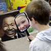 "Record-Eagle/Jan-Michael Stump<br /> The reflection of Rylea Beamish is seen in a mirror held by Cooper Norton during a lesson on diversity with United Way volunteer Brian Hall Friday in Charma Brian's second grade class at Eastern Elementary School. Hall read Dr. Seuss'""The Sneetches,"" a story of creatures -- some who have stars on their bellies, some who don't -- as part of the school's Martin Luther King, Jr. Day activities."