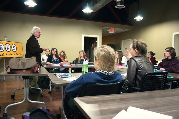 "Record-Eagle/Loraine Anderson<br /> Michael Delp, a poet and former Interlochen Arts Academy writing instructor and department. head, talks with Front Street Writers students Tuesday, Jan. 15.  ""Writing is really about seeing,"" he says. Students on the far side of the class are from left, back, Meg Caldwell and Jacqueline Ewing.  In front of them, from left are <br /> Ella Tutlis and Taylor Favour."