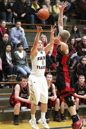 Record-Eagle/Keith King<br /> Traverse City St. Francis' Byron Bullough shoots the ball against East Jordan Friday, January 18, 2013 at Traverse City St. Francis High School.