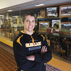 Record-Eagle/Keith King<br /> Mike O' Brien, a senior at Glen Lake High School, stands Wednesday, January 9, 2013 near the trophy case at Glen Lake High School which has a 2010 Division 4 regional championship golf trophy which he and his teammates won.