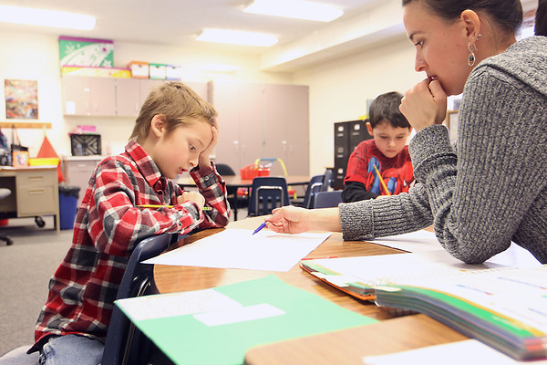 Record-Eagle/Jan-Michael Stump<br /> Kortney Hawkins, right, works with Jeremiah Kolarik, 8, left, and Kaleo Schaub, 6, on an assignment in their k-2 special education class at Kinglsey Elementary School Tuesday. Kingsley Schools finished in the top 10 for all-state academic honors in Bridge Magazine.