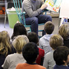 "Record-Eagle/Jan-Michael Stump<br /> United Way volunteer Brian Hall reads Dr. Seuss'""The Sneetches,"" a story of creatures -- some who have stars on their bellies, some who don't -- to Charma Brian's second grade class at Eastern Elementary School on Friday as part of their Martin Luther King, Jr. Day observances."