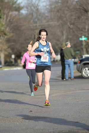 Record-Eagle/Jan-Michael Stump<br /> Sarah Drevon (397) was the women's winner in Saturday's Frozen Foot Race, a 5 mile road race in Traverse City.