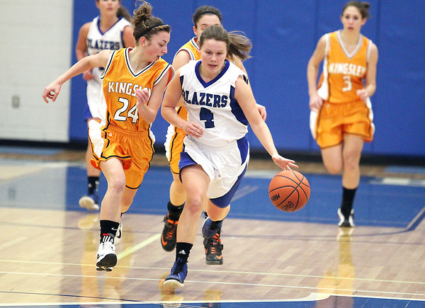 Record-Eagle/Keith King<br /> Kalkaska's Kelli Guy (4) dribbles the ball against Kingsley's Sarah Lueck (24) Tuesday, January 15, 2013 at Kalkaska High School.