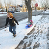 "Record-Eagle/Keith King<br /> Barb McGee, of Traverse City, pulls her daughter, Delaney McGee, 4, on a sled as they travel Monday, January 14, 2013 along Pine Street in Traverse City. ""Enjoying what we've got,"" Barb said about her and her daughter making the most of the snow that's recently fallen."
