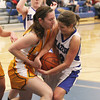 Record-Eagle/Keith King<br /> Kingsley's Amanda Youker, left, and Kalkaska's Alexis Hayden battle for control of the ball Tuesday, January 15, 2013 at Kalkaska High School.