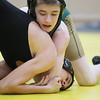 Record-Eagle/Keith King<br /> Traverse City West's Tyler Post, top, and Traverse City Central's David Matteson, wrestle Wednesday, January 16, 2013 at Traverse City West High School.