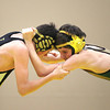 Record-Eagle/Keith King<br /> Traverse City Central's James Westenbarger, left, and Traverse City West's Vince Priante wrestle Wednesday, January 16, 2013 at Traverse City West High School.