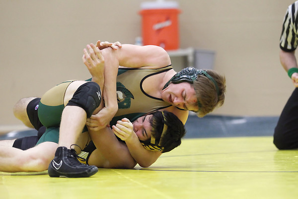 Record-Eagle/Keith King<br /> Traverse City West's Gabe Jasman, top, wrestles against Traverse City Central's Andre Passos in the 152-pound weight class Wednesday, January 16, 2013 at Traverse City West High School.