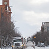 Record-Eagle/Keith King<br /> Heavy equipment is used to remove snow from Front Street Saturday in downtown Traverse City.