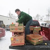 Record-Eagle/Keith King<br /> Nick Darga, of Traverse City, a CherryT Ball Drop board member, unloads food, which was donated during the CherryT Ball Drop celebration, to the Father Fred Foundation for the Father Fred Foundation food pantry.