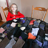Record-Eagle/Keith King<br /> Ada Maas, 9, sits Monday, December 2, 2013 near socks that she plans to donate.