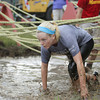 Record-Eagle/Keith King<br /> <br /> Becky Tomezak completes the final obstacle before reaching the finish line Saturday, September 7, 2013 during the King of the Mountain 5k at the Mt. Holiday Ski and Recreation Area in Traverse City.