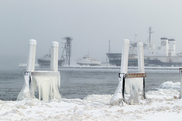 Record-Eagle/Keith King<br /> Ice forms on parts of a dock at West Bay Beach, a Holiday Inn Resort, Tuesday on West Grand Traverse Bay near the Great Lakes Maritime Academy.
