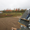 Record-Eagle/Keith King<br /> <br /> Bill Smith, of Bill Smith Roofing, works Wednesday, October 16, 2013 on a new home in Long Lake Township.