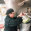 Record-Eagle/Keith King<br /> Jamie Washburne, owner, combines green pepper, onion and celery prior to sautŽing them Friday at Scalawags Whitefish and Chips as he makes his smokehouse no-bean chili with Maxbauer's Meat Market smoked chuck roast and smoked pork loin with fire-roasted tomatoes, in preparation for the 20th annual Downtown Chili Cook-Off at the Park Place Hotel Dome Saturday in Traverse City.