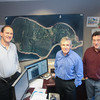 Record-Eagle/Keith King<br /> Alan Kostrzewa, from left, Craig Tester and Marty Lagina stand near a map of Oak Island, Nova Scotia at Heritage Sustainable Energy in Traverse City.