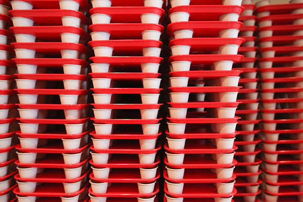 Record-Eagle/Keith King<br /> Trays and small bowls are stacked Friday in preparation for Saturday's 20th annual Downtown Chili Cook-Off at the Park Place Hotel Dome in Traverse City.
