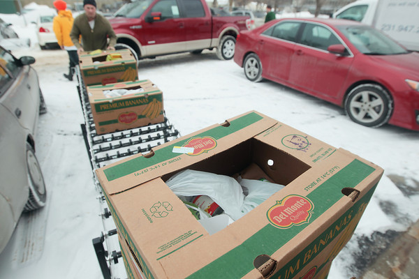 Record-Eagle/Keith King<br /> Food donated from the CherryT Ball Drop event is unloaded at the Father Fred Foundation for the Father Fred Foundation food pantry.