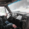 Record-Eagle/Keith King<br /> Jeff Newman, with the Grand Traverse County Road Commission, plows snow as he operates a truck Monday on South Airport Road in Traverse City.