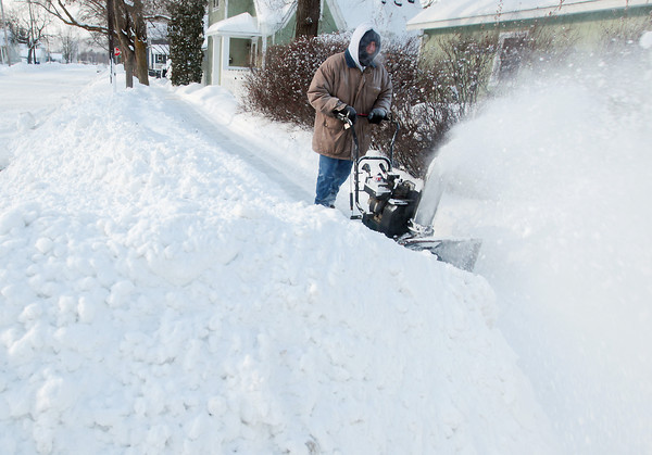 "Record-Eagle/Keith King<br /> Bill Black, of Traverse City, travels on a city sidewalk, after a City of Traverse City snow-blowing machine had gone through, as Black makes his way to clear snow from a neighbor's driveway. ""I'm on a roll,"" Black said."