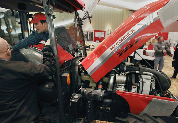 Record-Eagle/Keith King<br /> <br /> Adam Putney, of Arcadia, checks out a tractor Tuesday, January 18, 2011 during the 2011 Northweset Michigan Orchard & Tractor Show at the Grand Traverse Resort & Spa in Acme.