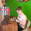 Record-Eagle/Keith King<br /> Briana Harrier, 15, of Interlochen, paints pop tabs Friday that she'll use to make pop tab bracelets. Harrier uses the bracelets to raise money for charity.