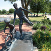 "Record-Eagle/Keith King<br /> Bicyclists pedal past the sculpture, ""Time to Let Go,"" by Verna Bartnick on Tuesday at Clinch Park in Traverse City. Construction at Clinch Park is expected to begin after Labor Day."