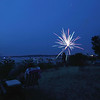 Record-Eagle/Keith King<br /> A firework explodes prior to the start of the Fourth of July fireworks by Great Lakes Fireworks over West Grand Traverse Bay Wednesday night.
