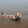 """Record-Eagle/Jan-Michael Stump<br /> Laura Janis, left, and her mother, Sharon Rochford, cool off in West Grand Traverse Bay on Thursday afternoon as temperatures hit the mid-90s. """"The men took the boats and left us the wine,"""" said Janis."""