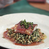 """Record-Eagle/Keith King<br /> Mario Batali's Michigan walleye in prosciutto with pesto fregola made by Mario Batali during the """"Made in Michigan"""" Epicurean Experience at Chateau Chantal on Old Mission Peninsula."""