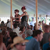"Record-Eagle/Jan-Michael Stump<br /> The ""Amazing Giants,"" Cate Owens, left, and Jessica Minshall of Columbus, Ohio, tower over the winery tent crowd on their stilts during The Fourth Annual Traverse City Wine and Art Festival Saturday at the Village at Grand Traverse Commons."
