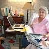 "Record-Eagle/Loraine Anderson<br /> Traverse City genealogist Brenda Moore is never far from the tools of her trade at her  ""little office"" in her room at Birchwood Nursing Center."