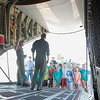 """Record-Eagle/Jan-Michael Stump<br /> AMT Todd Cook, left, and AET Jonathan Broadfoot of the U.S. Coast Guard talk about the Coast Guard's HC-130 """"Hercules"""" aircraft with campers from the Cit-County Day Camp during Friday morning's """"open ramp"""" at U.S.C.G Air Station Traverse City."""