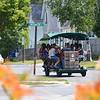 Record-Eagle/Dan Nielsen<br /> Clinton Cargill guides the human-powered TC Cycle Pub on Railroad Street.
