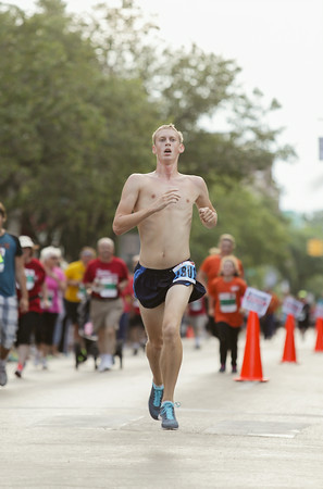 Record-Eagle/Keith King<br /> Steven Haagsma, of Wyoming, finishes first in the men's 10K during the National Cherry Festival Festival of Races.