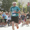 Record-Eagle/Keith King<br /> Roger Heeres, of Traverse City, nears the finish line after running in the 10K during the National Cherry Festival Festival of Races.
