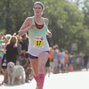 Record-Eagle/Keith King<br /> Katherine McCarthy, of Marne, finishes first in the women's half marathon during the National Cherry Festival Festival of Races.