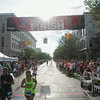 Record-Eagle/Keith King<br /> Runners cross the finish line on Front Street during the National Cherry Festival Festival of Races.