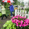 Record-Eagle/Keith King<br /> Kay and Jim Goodall, of Kewadin, walk at the Hresko Gardens during the Elk Rapids Garden Club Presenting Artful Gardens garden walk.