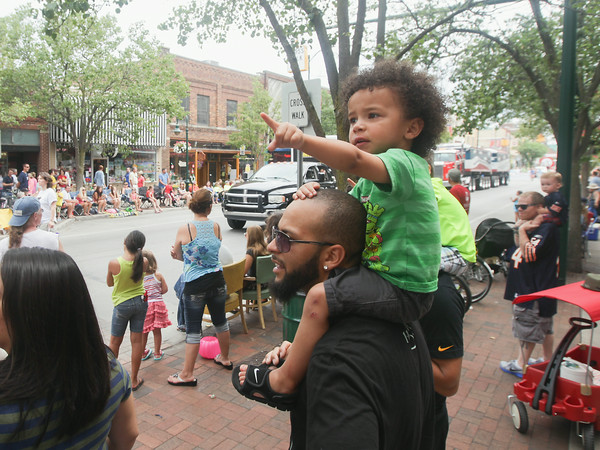 Record-Eagle/Keith King<br /> Aaron Andree, of Grand Rapids, holds his son Avery Andree, 3, on his shoulders during the National Cherry Festival Cherry Royale Parade.