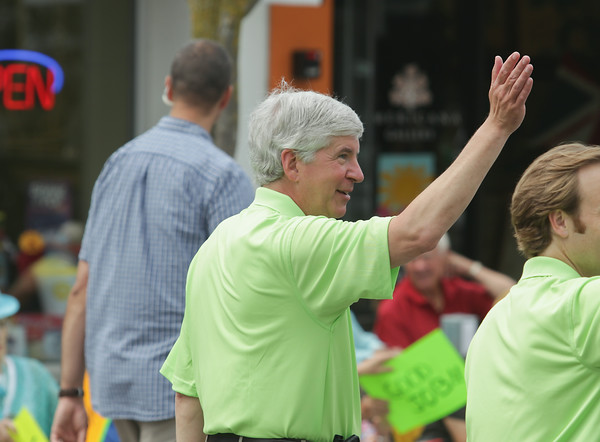 Record-Eagle/Keith King<br /> Gov. Rick Snyder waves during the National Cherry Festival Cherry Royale Parade.
